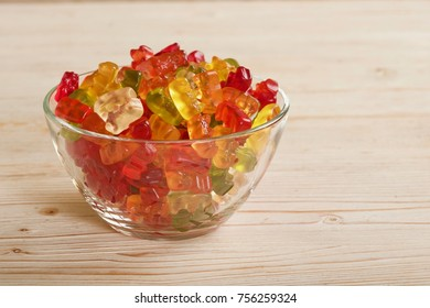 gummy bears on wooden background