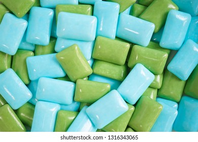 gums. A closed up details of colorful gum in blue and green.
