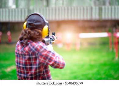 Gun aiming prepare to shoot in hand of old woman holding a riffle gun in practice,  arm and weapon martial art for woman