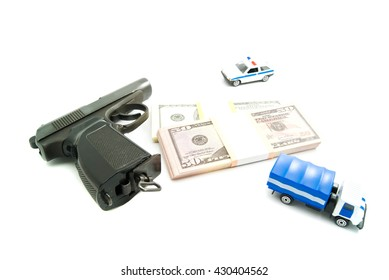 Gun, banknotes and police cars on white background