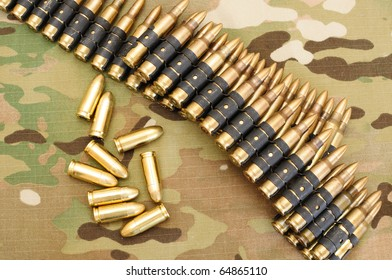 Gun belt, rounds for gun on multicam background