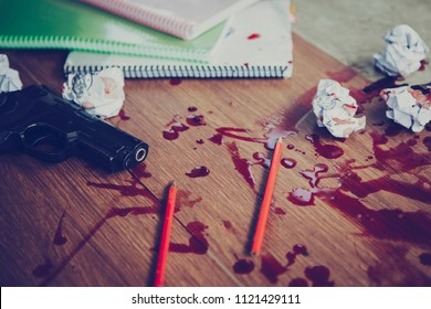 gun with books, red flesh blood and crumpled paper ball on concrete floor, committed suicide , conceptual image, Gun control concept
