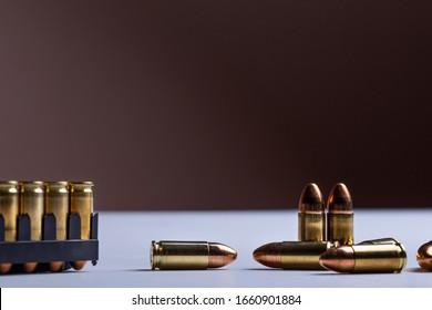 gun bullets cartridge 9mm on white table