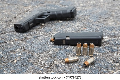 Gun Bullets and Clip on the City Pavement