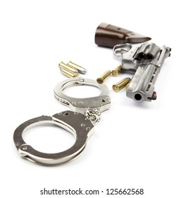 Gun, bullets and handcuffs isolated on white background