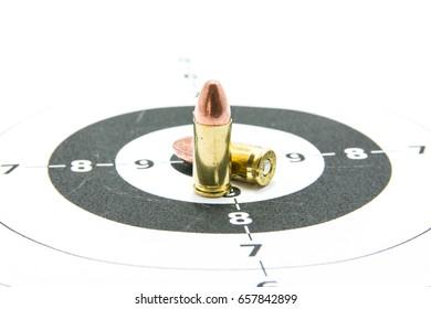 Gun and Bullets on shooting range.