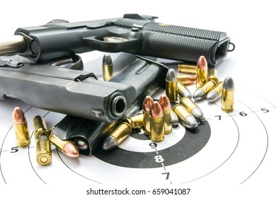 Gun and Bullets on shooting range Isolated on the white background.