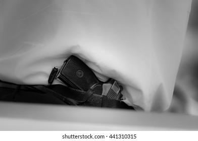 Gun is carried by a belt