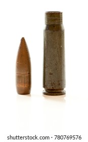gun cartridge with bullet and case on white background with reflexion