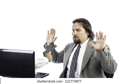 a gun coming out of a computer holding up a business man