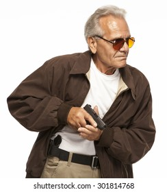 Gun Concealed Carry | PERSONAL DEFENSE | A mature man legally carries a firearm in a holster on his hip, concealed under a jacket.