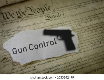 Gun Control news headline with gun shadow on US Constitution