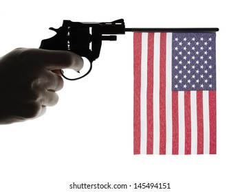 Gun crime concept of hand pistol showing the flag of united states of america