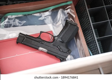 Gun in the drawer of the nightstand