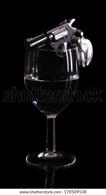 gun in a glass of wine