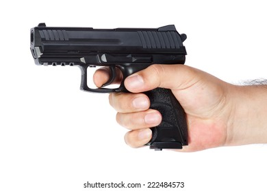Gun in the hand isolated on white background