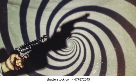Gun Hand Noir Swirl Shadows. Hand holding gun in shadows of swirl pattern, shot in film noir style and edited with vintage film effects.