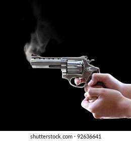 Gun in hand on Black background, Let the smoke out