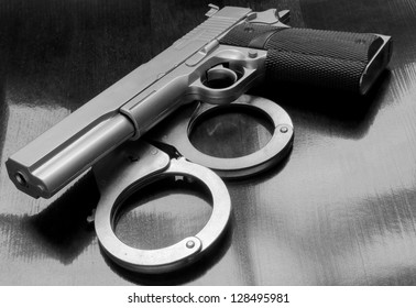 Gun and handcuffs on table