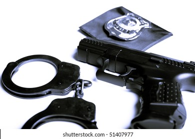Gun Handcuffs And Police Badge Isolated
