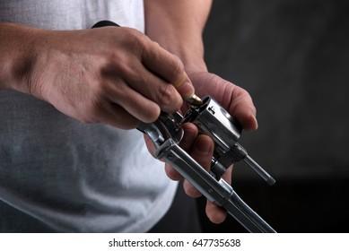 Gun in the hands of the man
