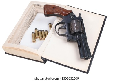 A gun hidden inside a book isolated on white background