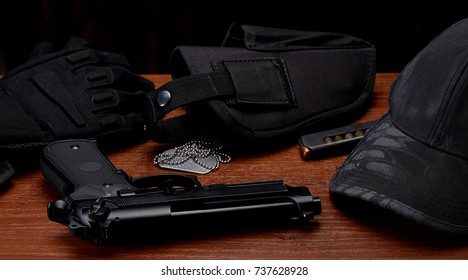 Gun, holster, dogtag, gauntlets and cap