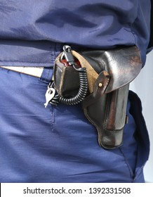 The gun in the holster on the belt of a policeman
