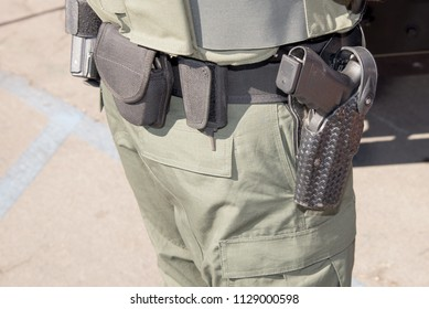 gun holster and utility belt worn by security guard