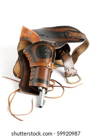 Gun and holster. Vintage western style six shooter with holster including belt with cartridge loops.