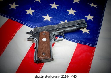 gun laid on the American flag close-up