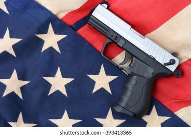 gun laying on a american flag