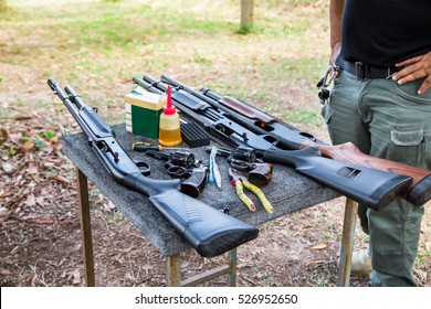 gun maintenance cleaning on table prepare for shooting training