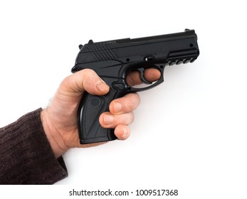 Gun in male hand isolated on white background