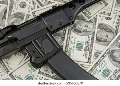 Gun On American Hundred Dollar Bills Background