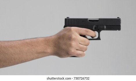 Gun on man hand