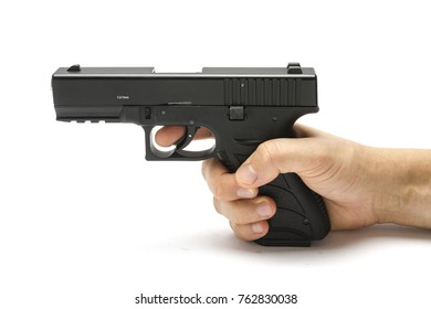 Gun, pistol in hand isolated on white