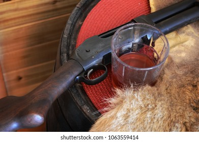 A gun is placed on the barrel table to stop in for a drink.