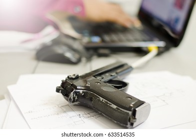 The gun is placed on a desk.