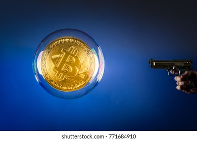 a gun pointing at a huge bitcoin in a bubble