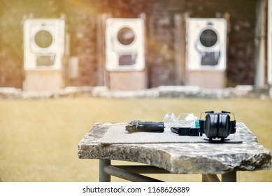 Gun, projectile, on the table in the shooting range