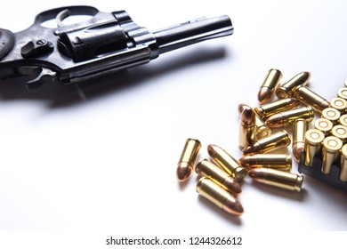gun revolver pistol and cartridge bullets isolated on white background