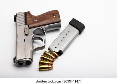Gun , Semi auto pocket hand gun with bullet magazine on white background