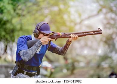 Gun shooting competition. Men are shooting guns.
