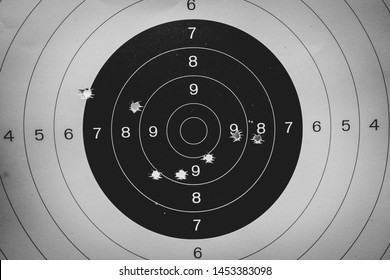 Gun shooting target paper in the shooting range with bullets hole.