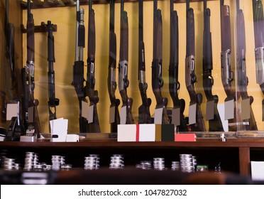 Gun shop interior with rifles on showcase