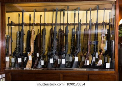 Gun store interior with rifles on showcase