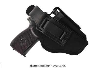 The gun in a tactical leather holster. Isolated
