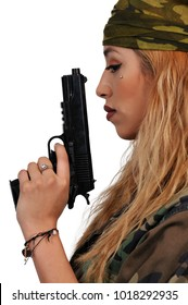 Gun toting beautiful young woman soldier with a pistol