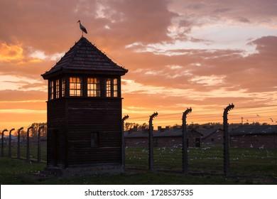 Gun tower at concentration camp in Auschwitz II - Birkenau at sunset